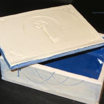 A whimsical box built using the slab method (Glazed clay, 2016)